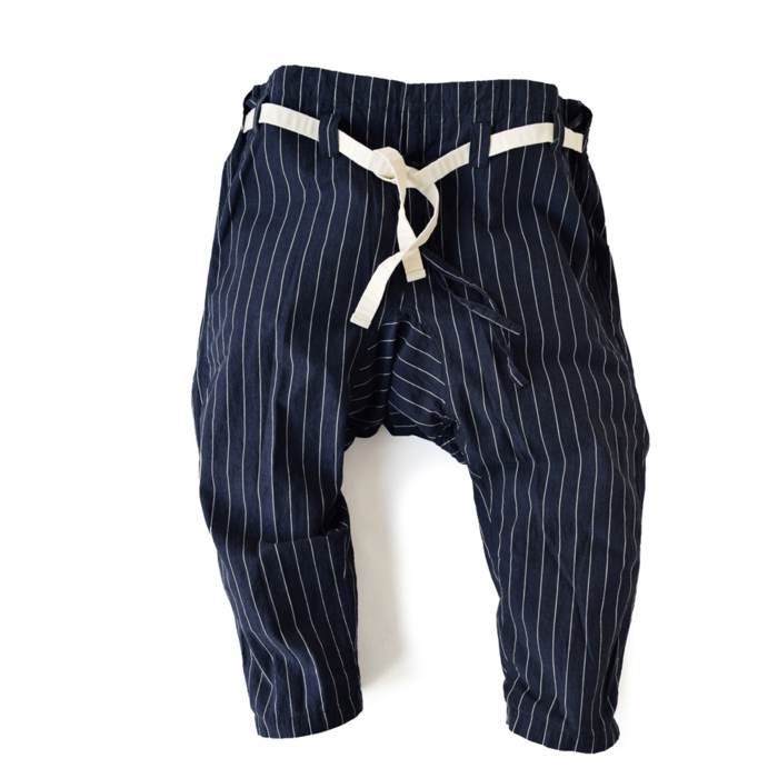 "<div style=""width:60px;display:inline-block;"">model</div> Karate Pants #12 ""Pinstripe""<br><div style=""width:60px;display:inline-block;"">color</div> white on indigo<br><div style=""width:60px;display:inline-block;"">material</div> 75% cotton, 25% Linen<br><div style=""width:60px;display:inline-block;"">price</div> 19,000JPY(+tax)"